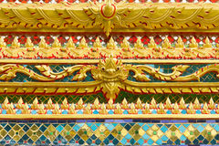 Traditional Thai temple ornament. Traditional Thai style art painting on temple for background Royalty Free Stock Photography