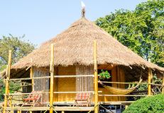 Traditional Thai Thatched Hut. Thai hut on stilts with thatched roof Royalty Free Stock Photo