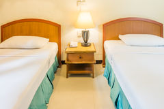 Traditional Thai twin bed room Royalty Free Stock Photo