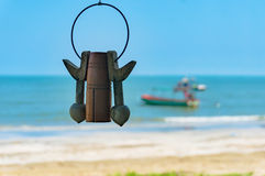 Traditional Thai wind rattle with beach on the background. Traditional Thai wind rattle with tropical beach and boat on the background Stock Photos