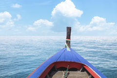 Traditional Thai wooden longtail boat in Andaman sea Stock Photo