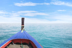 Traditional Thai wooden longtail boat in Andaman sea Royalty Free Stock Image