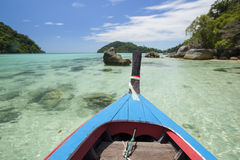 Traditional Thai wooden longtail boat in Andaman sea Royalty Free Stock Photo