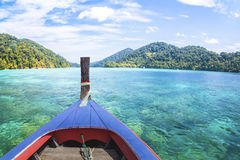 Traditional Thai wooden longtail boat in Andaman sea Royalty Free Stock Photos