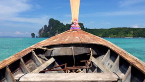 Traditional Thai Wooden Longtail Boat Ride. At Koh Phi Phi Island in Krabi Province stock video footage
