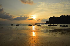 Traditional Thailand long tail boats at sunset Royalty Free Stock Images