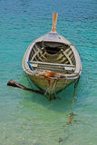 Traditional Thailand old long tail boat in transparent water Royalty Free Stock Image
