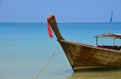 Traditional Thailand old long tail boat in transparent water Stock Image