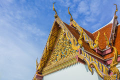 Traditional thailand temple. Details the roof of traditional thai temple and blue sky with clouds background Stock Photography