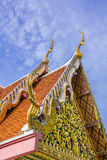 Traditional thailand temple. Details the roof of traditional thai temple and blue sky with clouds background Stock Photo