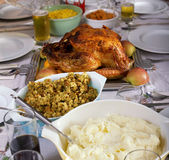 Traditional Thanksgiving Day holiday dinner. Thanksgiving holiday turkey and fixings including dressing, mashed potatoes, sweet potatoes and corn royalty free stock image