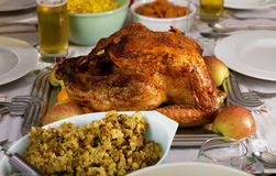 Traditional Thanksgiving Day holiday dinner. Thanksgiving holiday turkey and fixings including dressing, mashed potatoes, sweet potatoes and corn royalty free stock images