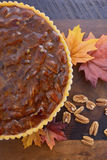 Traditional Thanksgiving Pecan Pie on Dark Wood Background. Stock Image