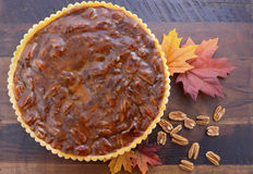 Traditional Thanksgiving Pecan Pie on Dark Wood Background. Royalty Free Stock Photography