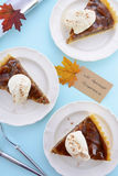 Traditional Thanksgiving Pecan Pie on Pale Blue Wood. Royalty Free Stock Image