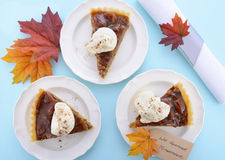 Traditional Thanksgiving Pecan Pie on Pale Blue Wood. Royalty Free Stock Photography