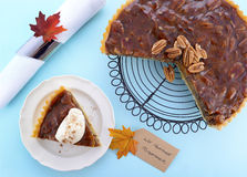 Traditional Thanksgiving Pecan Pie on Pale Blue Wood. Stock Photos
