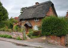 Thatched English Village Cottage Stock Photo