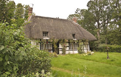 Traditional thatched roof cottage. Old english traditional thatched roof cottage Stock Photos