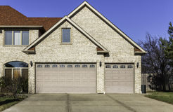 Traditional three car wooden garage Royalty Free Stock Images