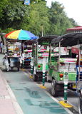 Traditional three-wheels THAI open air fun and well known BANGKOK and urban taxi Royalty Free Stock Image
