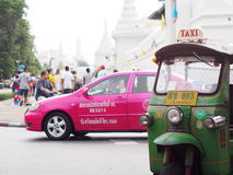 Traditional three-wheels THAI open air fun and well known BANGKOK and urban taxi Stock Photography