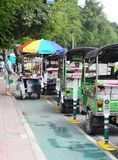 Traditional three-wheels THAI open air fun and well known BANGKOK and urban taxi Stock Images
