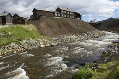 Traditional timber buildings of the copper smelter factory at the bank of Roa river in copper mines town of Roros, Norway. Roros town is declared a UNESCO Stock Photography