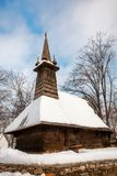 Traditional timber church covered in snow Stock Images