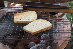 Traditional toaster. Charcoal brazier breakfast Stock Photography