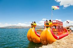 Traditional Totora boat on Titicaca lake in Puno, Peru. Titicaca lake, Puno, Peru - March, 20, 2017. Traditional Totora boat near Uros floating islands on Stock Images