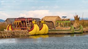 Traditional totora reed boat, Islas es los Uros, Lake Titicaca, Peru. Titicaca, Peru - September 2017: Traditional reed boat as transportation for tourists Stock Photos