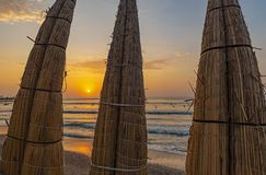 Traditional Reed Boats by the Pacific Ocean, Peru stock photo