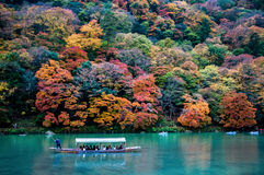 Traditional tourist boat pass on the emerald color Katsura river Royalty Free Stock Images