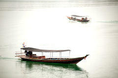 Traditional tourists boat  in Cheow Larn lake,Thailand. Stock Photo