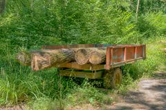 Traditional trailer with tree trunks stock photos