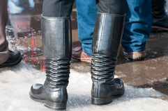 Traditional Transylvanian hungarian black leather boots. At the winter ending carnival Stock Image