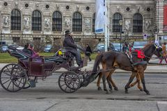 Traditional travel on a trip with horse carriage ride in the center of Vienna. Austria, Vienna 30,12,2017 Traditional travel on a trip with horse carriage ride royalty free stock photos