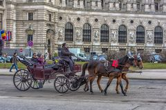 Traditional travel on a trip with horse carriage ride in the center of Vienna. Austria, Vienna 30,12,2017 Traditional travel on a trip with horse carriage ride royalty free stock image