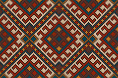 Traditional Tribal Aztec seamless pattern on the wool knitted texture Royalty Free Stock Images