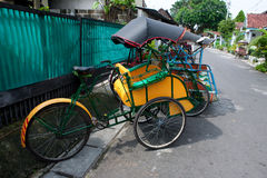 Traditional trishaw in the streets of Jogjakarta, Stock Photo