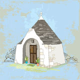 Traditional Trulli house with conical roof on the textured background Royalty Free Stock Image