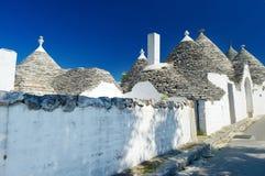 Traditional trulli houses in Alberobello Stock Photos