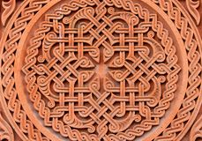 Traditional tufa stone carving ornament on a wall of Armenian Orthodox Church royalty free stock images