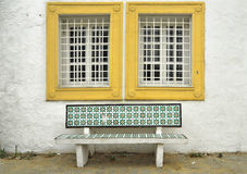 Traditional Tunisian bench. Under a window stock image