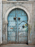 Traditional tunisian door. Damaged old Tunisian front door royalty free stock images