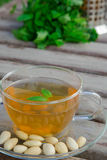 Traditional tunisian green tea with peppermint and nuts Stock Photos