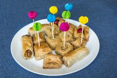Turkish Ramadan Dessert Baklava with Party Sticks. Traditional Turkish Arabic Dessert - Baklava with Nuts royalty free stock images