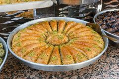 Traditional Turkish baklava sweets in the open buffet in a hotel in Turkey stock photo