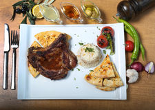 Traditional turkish beef stake with bulgur pilav. Vegetables, bread and lemon juice, olive oil Stock Image